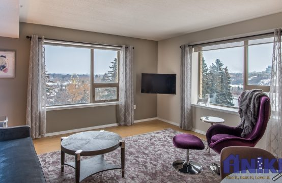 Fully furnished room with corner windows overlooking river, Kinsmen park, and views to the hospitals