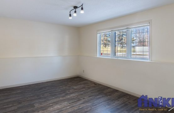 Nutana Park, Saskatoon Basement Suite for Rent - spacious living room with large windows and lots of natural light.