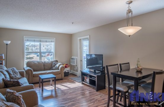 Open concept living and dining room with lots of light, adjoining balcony, and views from kitchen